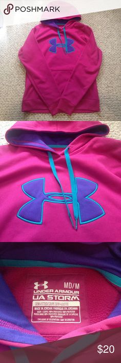 Women's under armour hoodie! Dark pink, purple and teal size medium. Semi-fitted storm hoodie. Excellent used condition! Under Armour Tops Sweatshirts & Hoodies