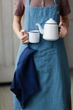 Our inner Julia Child is aching to tie on this blue linen apron and start cooking up a storm.