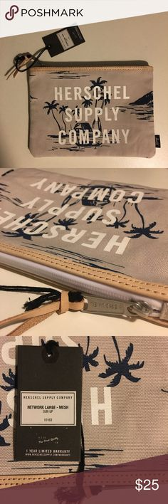 """Herschel Supply Co. Network Pouch Herschel Supply Co. Large Network Pouch in """"Sun Up"""" Has the brand name screen printed on the front. Beige pouch with navy print. Real leather trim. Herschel Supply Company Bags Travel Bags"""