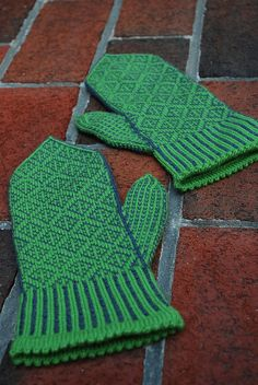This stranded mitten pattern is the same on both sides, so the mittens are interchangeable. It features a gusseted thumb and a tapered top as well as an option for a picot cuff. It is knit in two contrasting colors.