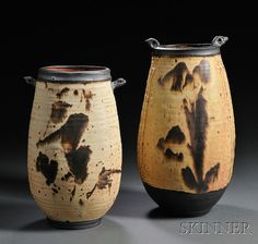 """Two Large Otto Heino Wood-fired Stoneware """"Nest"""" Vases Both vases of similar design, slightly bulbous bodies tapering to, in semi-matte cream glaze with brown and rust slip trails and accents to rims, bodies, and bases, incised and impressed decoration descending below stylized """"bird"""" handles at rim, incised Otto + 07 and Otto + 03 respectively, some glaze misses to rim, larger ht. 13 1/2 in. Otto made the one on the left at age 92 and the one on the right at age 88....amazing !"""