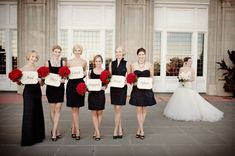 bridesmaids-black-and-white-dresses-red-bouquets {{Our scheme is red, black, and white. Change the bride's bouquet to red and I think this may be perfect}}.