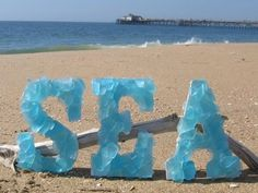do the baby's name in seashells, or sea glass