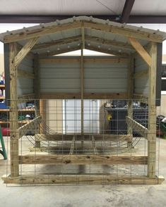 Goat round bale feeder. Hay, roll, covered