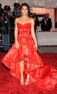 2009: Sun-kissed Jessica Biel, on the other hand, played the muse to Versace in a corseted red gown with a hi-low hemline. - Met Gala: The 30 best gowns of all time
