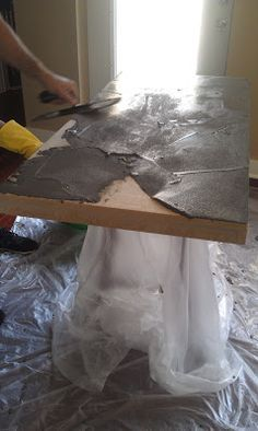 Resurfacing the table top with concrete CHEAP IDEA!
