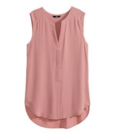 Sleeveless V-neck blouse in woven fabric. Concealed buttons at front, raw edges at neckline and armholes, and rounded hem. Slightly longer at H&M Sleeveless Blouse - Dusty rose - Ladies - ShopStyle Button Front for my stylist - Dusty rose sleeveless blou Casual Outfits, Cute Outfits, Fashion Outfits, Womens Fashion, Dress Casual, Mode Glamour, Dress Patterns, Blouse Designs, Lehenga