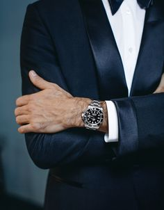 Rolex Testimonee Roger Federer, wearing a Rolex Submariner Date with black dial. A perfect match for a black tuxedo and double cuff.