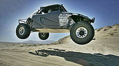 This all-electric Baja racer is running the NORRA Mexican 1000. A 450 hp off-road lightning bolt strikes the desert. - Road & Track