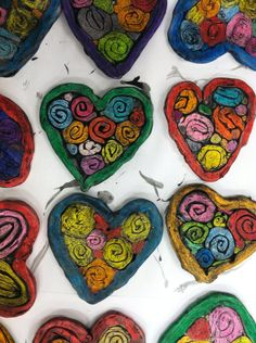 clay hearts... http://ourartroomrocks.blogspot.com/2010/02/kindergarten-clay-hearts.html   colored with crayons and painted with water downed black tempera.. romero britto is a great tie in