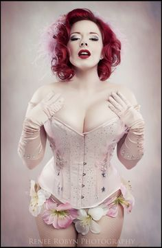 Burlesque performer Lucky L'Amour. Corset by Sweet Carousel Corsetry. Photographer is Renee Robyn.