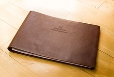 An A3 Leather Family History Album. Made from a single piece of Italian veg tanned bridal leather, the album has a blind embossed cover. It uses screw post fixing.