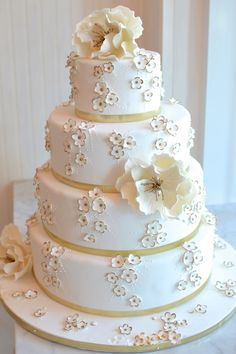 4 Tier Ivory Cake with Large Flower Details & Small Mini Floral Accents with Bronze Metallic Edging