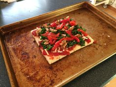 #FODMAP Friendly Veggie Pizza!  GF crust topped with tomatoes, glazed walnuts, spinach, and roasted red peppers.