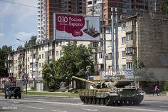 04-01 DONETSK, UKRAINE - JULY 21: A tank operated by pro-Russia... #artena: 04-01 DONETSK, UKRAINE - JULY 21: A tank operated by… #artena