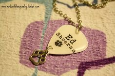Ed Sheeran Pawprint Logo Guitar Pick Necklace by Shanana on Etsy, $15.00