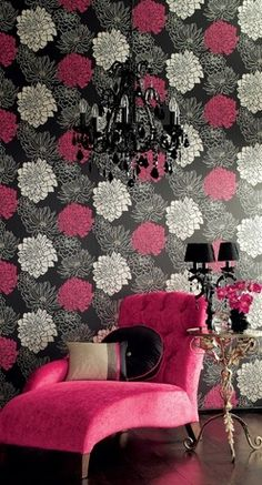Whilst not really a decorative accessory, this wallpaper works beautifully with the pink chaise, black chandelier and small table.