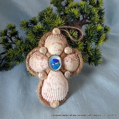 Coastal Christmas sea shell cross ornament by CarmelasCoastalCraft