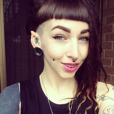 Elf point, tragus, gauged ears, side shave, dimples, septum, and lastly braces.