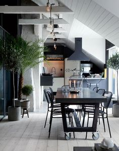 Scandinavian interior design | dinning table on wheels, exposed beams , white and black