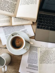 Messy books and coffee flatlay study studying studyblr notes laptop books school coffee tea time mot