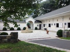 Cobblestone Stable Courtyard with Provencal Fountain Peter Dorne AIA- stable architect Celia K DeHuff - landscape architect Equestrian Stables, Horse Stables, Horse Farms, Dream Stables, Dream Barn, House With Stables, Horse Barn Designs, Horse Barn Plans, Farm Barn