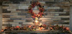 simple fall mantle decor with scarecrow, deer antlers and wreath.