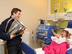 Amazing photo: Irish rugby captain Brian O'Driscoll meets 6-year-old Michaela Morley from Co. Mayo, in Dublin's Temple Street Hospital.