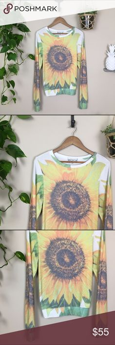 🌸Wildfox jumper!!! 🌸Wildfox Couture Big Sunflower Baggy Beach Jumper, shine bright BB. This This pullover jumper features a pretty, yellow sunflower in an allover, daydream sublimation print. With a scoop neck, banded hems and a roomy fit that hangs off the body perfectly.  Materials: 47% Rayon, 47% Polyester, 6% Spandex Good used condition. Not as soft as newer sweaters.   🍍offers welcomed,no trades🌊 Wildfox Tops Sweatshirts & Hoodies