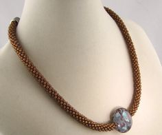 Copper Beaded Kumihimo Necklace by Luckysammy on Etsy https://www.etsy.com/listing/122341942/copper-beaded-kumihimo-necklace
