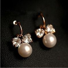 Pearl bow zircon earrings