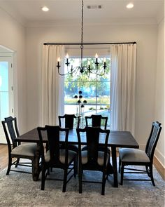 Effortless and Chic. Our client wanted to add softness to her dining room without committing to color. We chose a simple woven white cotton fabric with flat panel design and matte black hardware to make the drapes and chandelier pop in the room. Drapery Styles, Dining Chairs, Dining Room, White Flats, White Cotton, Matte Black, Cotton Fabric, Chandelier, Hardware