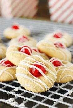 With their white chocolate-drizzled maraschino cherries perched prettily on top, these adorable little Cherry Almond Cookies are one tasty treat! Perfect for Christmas cookie trays, cookie exchanges, Valentine's Day treats . or, for everyday enjoying. Cherry Desserts, Cherry Recipes, Lemon Recipes, Cookie Desserts, Cookie Recipes, Cherry Cookies, Lemon Cookies, Holiday Cookies, Almond Sugar Cookies