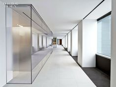 A corridor separates the glassed-in boardroom from the perimeter. by  Mayfield and Ragni Studio