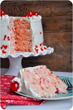 Three layer cherry almond sour cream cake filled with cherry frosting & topped with flour based frosting. Perfect red & white cake for Valentine's Day!