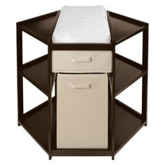 I had no idea these existed! Brilliant layout. (Badger Basket Diaper Corner Baby Changing Table with Hamper - Espresso. Just google 'corner baby changing table and a bunch of affordable options come up. This one is from Target.)