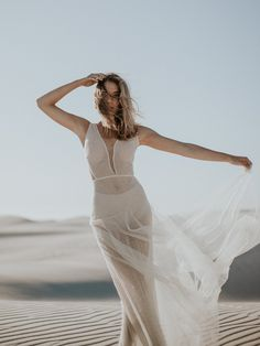Dreamy Desert Wedding Inspiration by Thunder & Love | SouthBound Bride Photography: Thunder & Love Wedding Photography | Styling, co-ordination, floral & decor: Happinest Weddings | Stationery: Oh Yay | Bride's dress: Brit & Bride | Hair & makeup: Makeup by Almari | Model: Martina Nicoletti of 3D Model Management | stunning long dress with sleeves