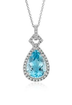 This beautiful 'something blue' features an aquamarine gemstone surrounded by a stunning halo of brilliant round diamonds framed in 18K white gold.