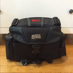 Canon Rebel camera bag (with strap included!) Awesome Canon Rebel camera bag with tons of storage space! Never used! Includes an adjustable strap that can be attached. Canon Bags