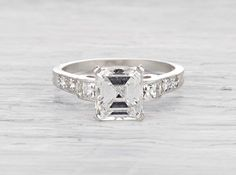 Art Deco Tiffany & Co. vintage engagement ring with a 2.03 carat emerald cut diamond circa 1925