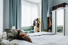 Blue bedroom in Cozy Cluttered Stockholm Apartment