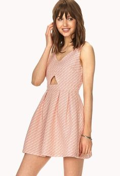 An A-line dress featuring a geo pattern and cutout accents. V-neckline. Pleated waist. Invisible ...
