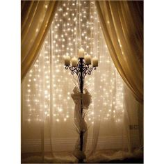 New Year's Decor-love the lights behind the curtains