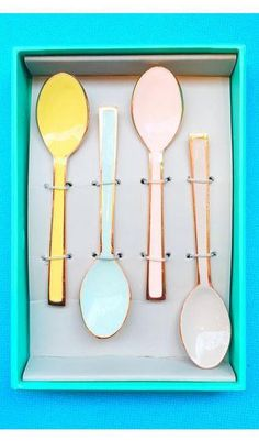 Set of four enamel coated teaspoons in a selection of lovely pastel colours, perfect for tea parties. image by bespokebride.