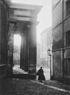 André Kertész. Figure and column w street lamp, 1925
