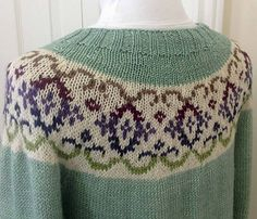 This cosy form fitting sweater has a yoke with a brocade Fair Isle pattern that has a kaleidoscope effect when knit in several colours. What a great way to use up scraps of all your favourite colours. Knit in a DK weight and includes sizes small to extra large.