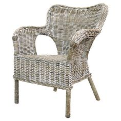 Perfect paired with a burlap pillow or pulled up to a weathered dining table, this rattan arm chair adds cozy, rustic appeal to any room in your home.  ...
