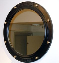 1000 images about bathroom mirrors cabinets on pinterest for Porthole style mirror