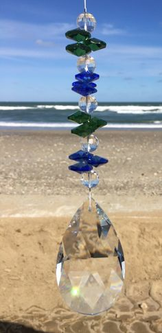 Crystals sparkle best when the sun is bright. CristalierCrystals.com Driftwood Mobile, Glass Wind Chimes, Hanging Crystals, Fairy Garden Accessories, Glass House, Diy Projects To Try, Suncatchers, Diy And Crafts, Blue Green