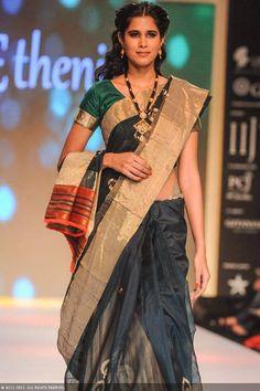 A model showcases a design by the jewellery brand Shringar during the India International Jewellery Week (IIJW), held at Grand Hyatt, Mumbai, on August 06, 2013.